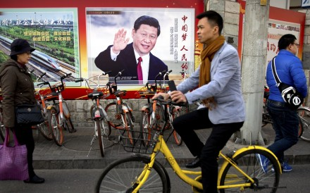 A billboard featuring President Xi Jinping in Beijing, where China's top legislative bodies are meeting. Photo: AP