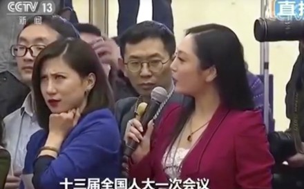 Liang Xiangyi, a reporter for China Business News, gives an epic eye-roll as fellow journalist Zhang Huijun asks a tedious question to a government minister. Photo: CCTV