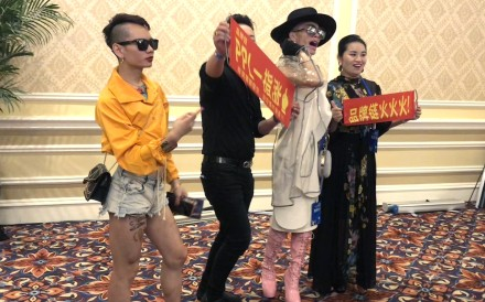 Entertainers try to drum up interest in a blockchain product at a conference in Macau. Pthoto: Orange Wang
