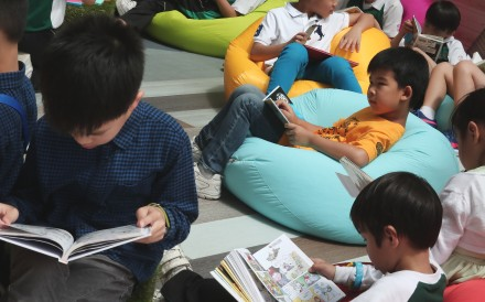 "Young readers at the Hong Kong government's ""My Pop-up Library"" event, part of the 2018 World Book Day Fest, in Sham Shui Po on April 21. Photo: Jonathan Wong"