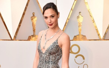 Gal Gadot, star of Wonder Woman, walks down the red carpet at the 90th Academy Awards ceremony in a Tiffany and Co. 2018 Blue Book necklace also known as 'Blue Ice'.