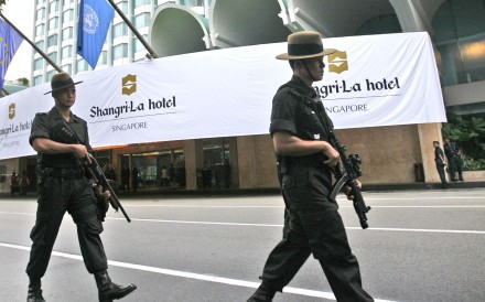 Singapore police officers patrol outside the Shangri-La hotel. Photo: AP
