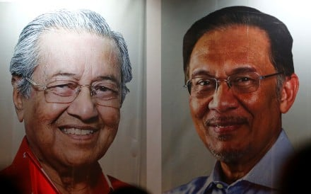Posters of Malaysian Prime Minister Mahathir Mohammad and pardoned politician Anwar Ibrahim, in Kuala Lumpur, Malaysia. Picture: Reuters