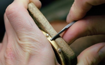 An artisan uses the Rigato engraving technique on a bracelet.