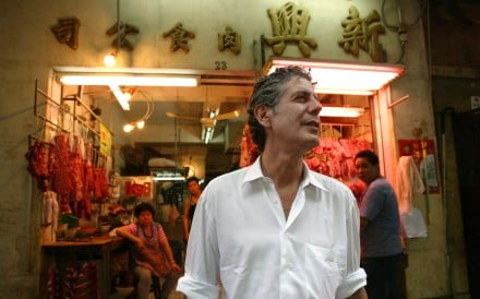 Anthony Bourdain walking through the wet markets of Hong Kong on his food tour of the city in 2005. Photo: Dickson Lee