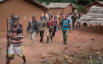 In this photograph taken on August 16, 2017, anti-Balaka combatants patrol in the parish of Gambo, southeastern Central African Republic. Photo: Agence France-Presse