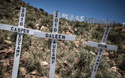 Crosses are planted on a hillside at the White Cross Monument, each one marking a white farmer who has been killed in a farm murder, on October 31, 2017 in Ysterberg, near Langebaan, South Africa. Photo: Agence France-Presse