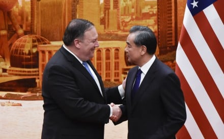 US Secretary of State Mike Pompeo shakes hands with Chinese Foreign Minister Wang Yi after a joint press conference at the Great Hall of the People in Beijing on June 14, 2018. Photo AFP