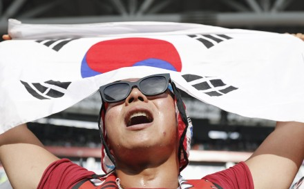 A South Korean supporter cheers at the Kazan Arena in Kazan, Russia, during the game against Germany on June 27. Photo: Kyodo