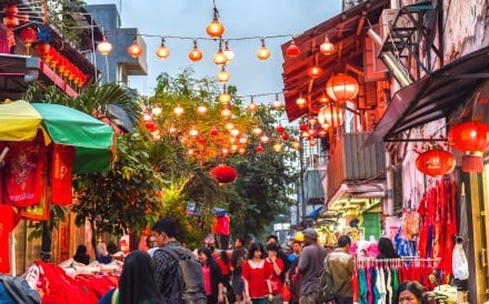 A walkway with hanging lamps and lanterns in Jakarta's Old Town district. Photo: Alamy
