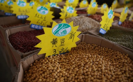 Soybeans for sale are displayed in a grain wholesale market in Beijing on July 31. Photo: EPA-EFE