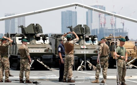 The drill was to include Japan's controversial amphibious brigade, which was formed to counter any threats against islands along edge of East China Sea that Tokyo worries could be vulnerable to attack by China