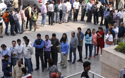 Snaking queues at a bank in New Delhi, India, as people rush to exchange discontinued currency notes, on November 16, 2016. On November 8, Prime Minister Narendra Modi had abruptly announced in a nighttime TV address that all 500- and 1,000-rupee notes were to be immediately withdrawn from circulation, to fight corruption and target tax evaders. Photo: AP