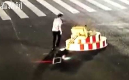 A motorist in central China was detained for demolishing a temporary traffic light in an apparent fit of pique. Photo: Handout