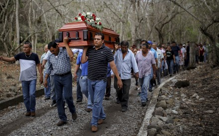 In this March 8, 2017, photo, members of the Solecito search group carry the coffin of Pedro Huesca, a police detective who disappeared in 2013 and was recently found in a mass grave, as they walk to the cemetery in Palmas de Abajo, Veracruz, Mexico. Veracruz is the location of a new mass grave, containing at least 166 human skulls. Photo: AP