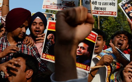 A protest against billionaire jeweller Nirav Modi and India's Finance Minister Arun Jaitley in the wake of the Punjab National Bank banking fraud scandal in New Delhi. Photo: AFP