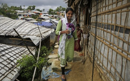 Rahima Akter walks through Balukhali refugee camp in Bangladesh. Photo: AP