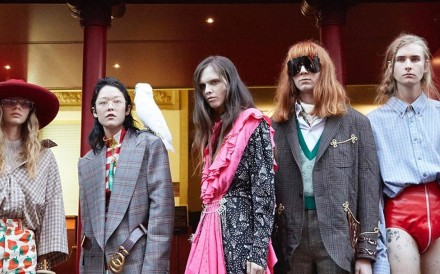 Models in front of Théâtre Le Palace where the Gucci spring/summer 2019 show was held. The luxury maison is encouraging millennials to 'Guccify'.