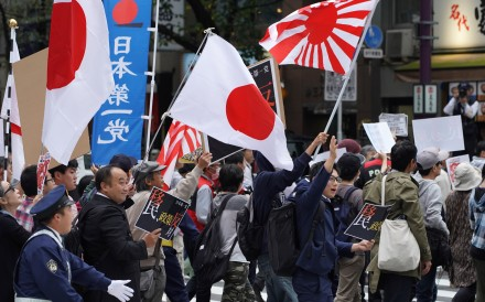 Demonstrators at a rally against Japan Prime Minister Shinzo Abe's proposed legislation regarding foreign workers. Photo: Bloomberg