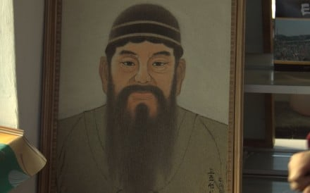 A picture of King Dangun, the mythical founder of the first unified Korean kingdom in 2333 BCE, sits at a tourist stand near what North Korea says is his tomb, just outside Pyongyang. Photo: Reuters