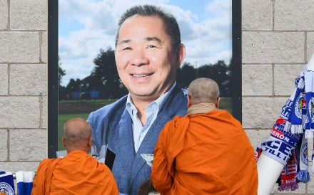 Buddhist monks lay tributes by a photograph of Leicester City's Thai chairman Vichai Srivaddhanaprabha, outside the King Power Stadium. Photo: AFP