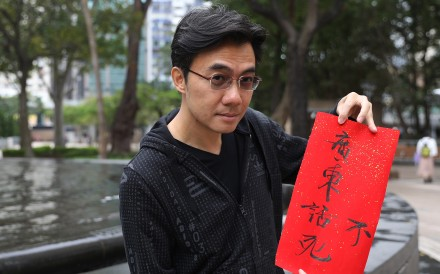 "Benjamin Au Yeung Wai-hoo, aka ""Ben Sir"", a former senior lecturer in Chinese at the Chinese University of Hong Kong, poses with a banner saying ""Cantonese won't die"". Au quit his job for his mission to revitalise the indigenous culture of Hong Kong, Guangdong province and other parts of southern China through star power. Photo: Sam Tsang"