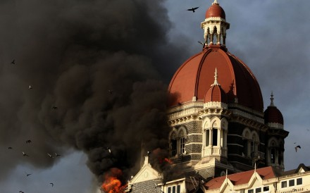 Fire and smoke billows from the Taj Mahal Palace hotel in Mumbai in November 2008. Photo: AFP