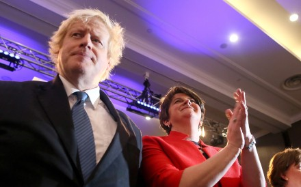 Former British Foreign Secretary Boris Johnson (left) and leader of the DUP Arlene Foster participate in the Democratic Unionist Party (DUP), Annual Conference in Belfast. Photo: AFP