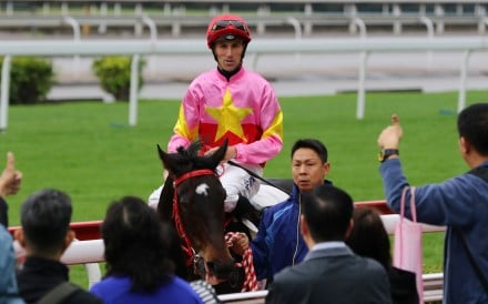 Tye Angland returns to scale after winning aboard Follow Me on Sunday. Photo: Kenneth Chan