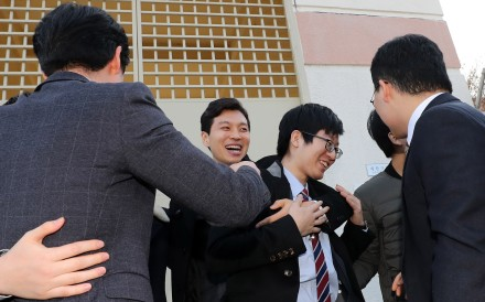 A conscientious objector rejoices with family members after being released on parole from a detention house in Daegu, South Korea. Photo: EPA
