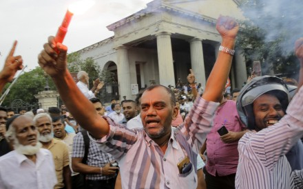 Supporters of ousted Sri Lankan Prime Minister Ranil Wickremesinghe celebrate the court's verdict. Photo: AP