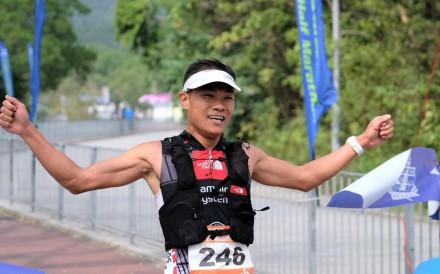 Wong Ho-chung raises his arms at the finish. Photo: HKAAA