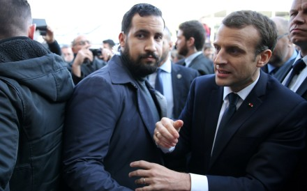 Former senior security officer Alexandre Benalla next to French President Emmanuel Macron during a visit to the Paris International Agricultural Show in February. Photo: Reuters
