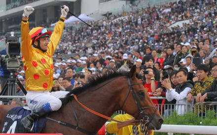 Douglas Whyte celebrates after winning the 2013 Hong Kong Cup with Akeed Mofeed. Photo: Kenneth Chan