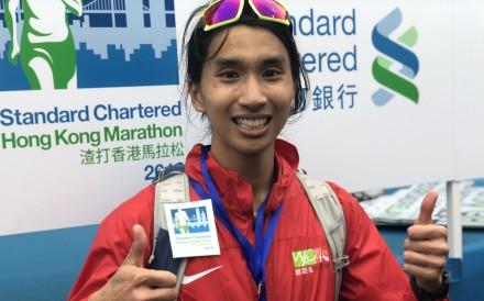 Hanniel Chow Hon-nip celebrates his performance as the best local runner at the Hong Kong Marathon. Photo: SCMP