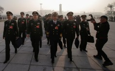 Military delegates arrive at the Great Hall of the People for the National People's Congress on Tuesday. Photo: Reuters