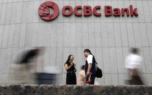 Fitch puts OCBC on negative watch after Wing Hang deal