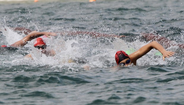 The dangers of open water swimming in triathlons and how to minimise the risks