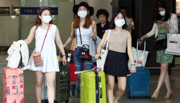 Hong Kong's health authorities play down South Korean alert over rising flu toll