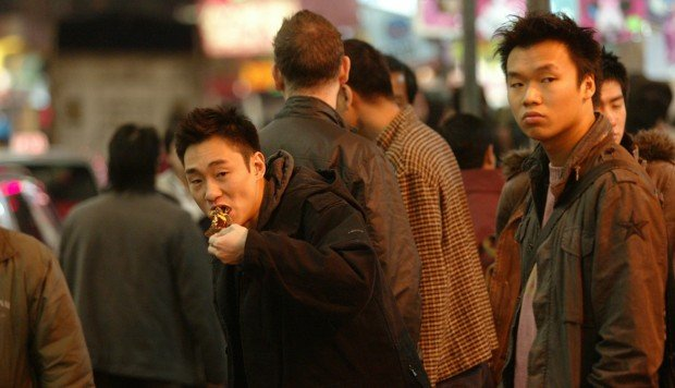 People eating foods on the street at Dundas Street, Mongkok. Photo: Edward Wong