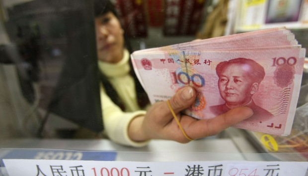 China's yuan eases slightly, ending two days of gains against greenback   South China Morning Post