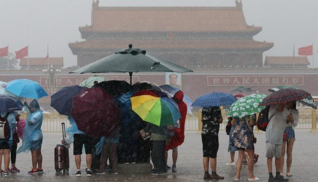 Flights cancelled as wild weather lashes China