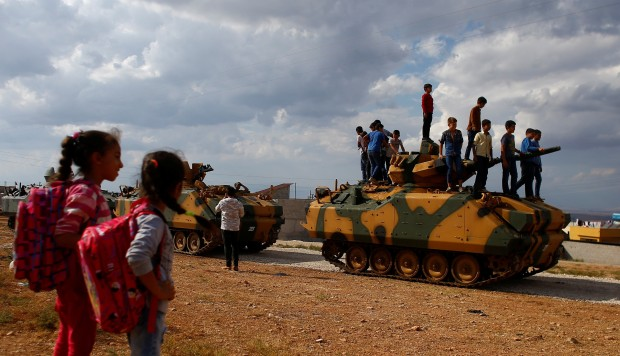 Turkey sends forces, sets up positions in Syria's Idlib province to contain Kurdish militia