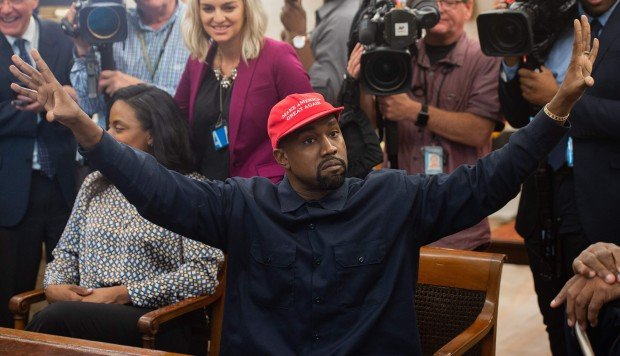 Kanye West at the White House hugs, talks with Trump