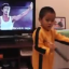 The boy handles the nunchucks with ease, swirling them in unison with the Bruce Lee scenes playing in the background. Photo: YouTube