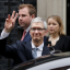 Apple CEO Tim Cook waves at members of the media as he leaves 10 Downing Street in London. Photo: AP/Matt Dunham