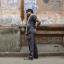 Labourers speak on mobile phones opposite a public call office (PCO) in a market area in Kolkata, India. Photo: Rupak De Chowdhuri/Reuters