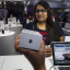Aarushi, the first customer to buy an Apple Inc. iPhone 6s at an iZenica store, operated by Zenica LifestylePvt., waits to pay during a midnight launch event for the iPhone 6s in New Delhi, India in October, 2015. Photo: Prashanth Vishwanathan/Bloomberg/Getty Images