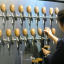 An employee at the Amazing Brewing Company pours beer from one of the brewpub's 59 taps. The brewpub boasts the largest number of taps in the country. Photo: Yun Suh-young/Korea Times