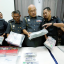 Domestic Trade, Cooperatives and Consumerism Ministry (KPDNKK) enforcement division director Datuk Mohd Roslan Mahayudin with the seized items. Photo: Ramdzan Masiam/New Straits Times